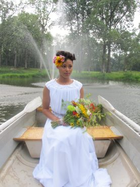 A beautiful bride on a boat ride across the lake at Burdoc Farms.