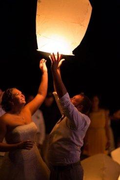 A bride and groom set free a paper lantern at Burdoc Farms.
