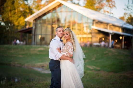 A bride and groom hold each other at Burdoc Farms