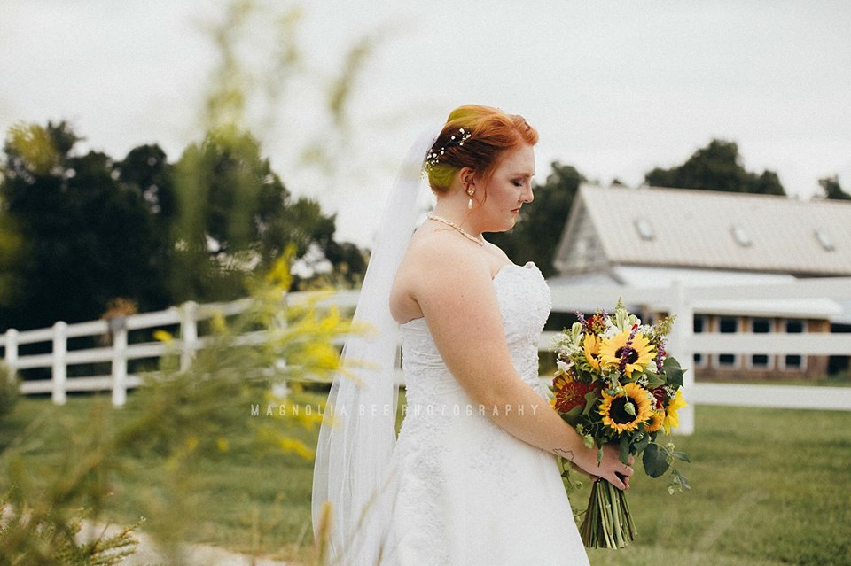 A bride holds a beautiful bouquet.